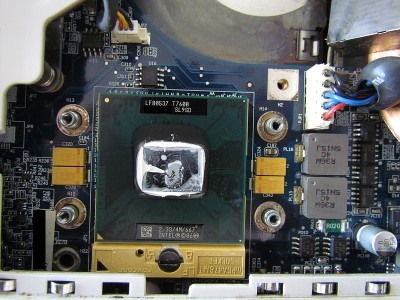 [ Arctic Silver Ceramique squeezed out from between CPU and heatsink contact surfaces ]